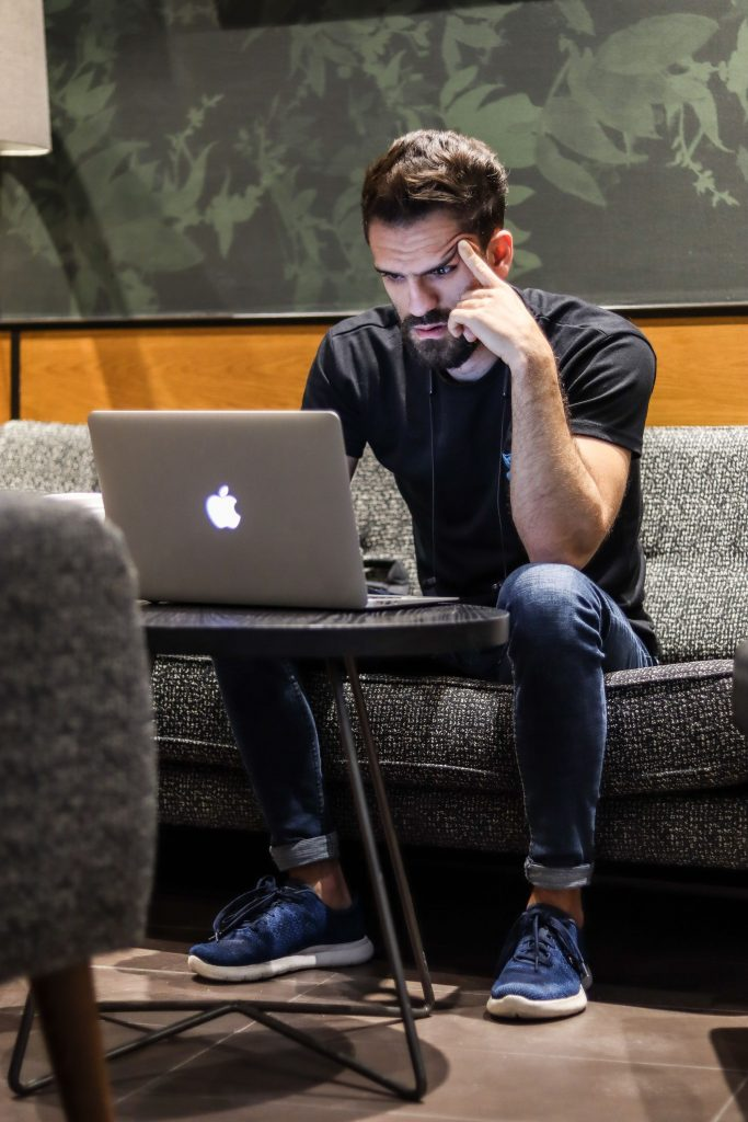 Amir Sebai on his laptop